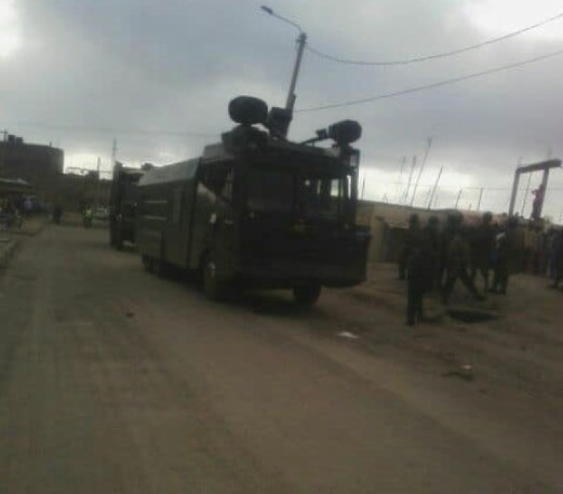 A police water canon placed strategically at Jacaranda